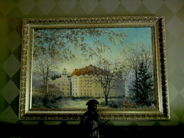 painting of hotel above fireplace